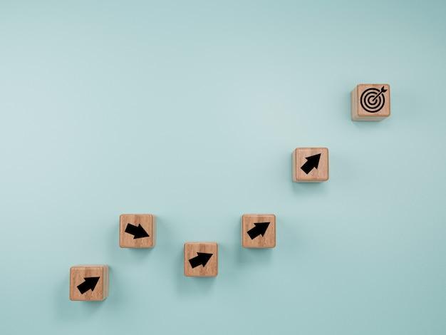 Wirtualna tablica docelowa i strzałka, która drukuje ekran do drewnianego bloku kostki na niebieskim tle. cel osiągnięcia firmy i koncepcja celu obiektywnego.