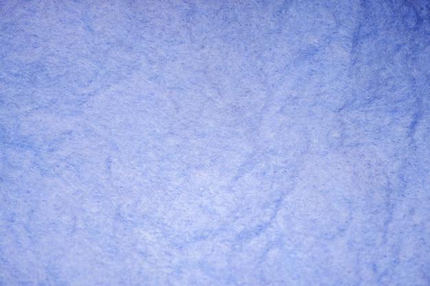 Włókienniczych tło z bliska niebieski teksturowanej szmatki