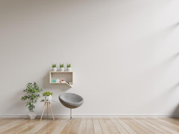 Wnętrze ma fotel na pustej białej ścianie.