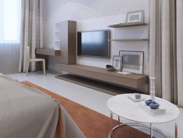 Wnętrze nowoczesnej sypialni z zamontowanym na ścianie telewizorem
