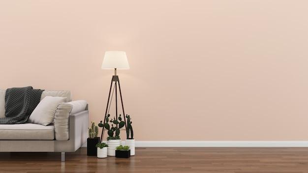 Wnętrze salon różowy pastelowa ściana biała sofa drewniana lampa podłogowa roślina