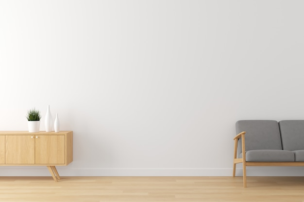 Wnętrze salonu biała ściana, drewniana podłoga i szara konfiguracja sofy do reklamy z pustą przestrzenią na tekst.