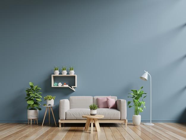 Wnętrze salonu z sofą i zielonymi roślinami, lampą, stołem na granatowej ścianie