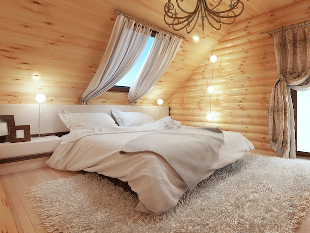 Wnętrze sypialni z bali na poddaszu z oknem dachowym