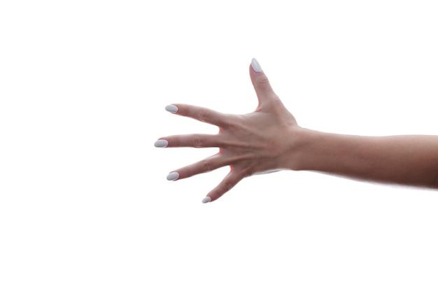 Womans ręka pokazująca numer pięć.