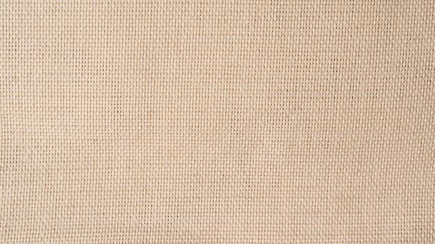Wory płótno tkane tekstura tło. tkanina lniana organiczna w kolorze beżowym.