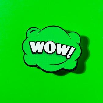 Wow komiczna ikona nad zieloną tło wektoru ilustracją