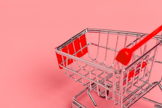 Wózek na zakupy lub supermarketa tramwaj na różowym tle