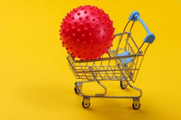 Wózek na zakupy z piłką do masażu na żółto