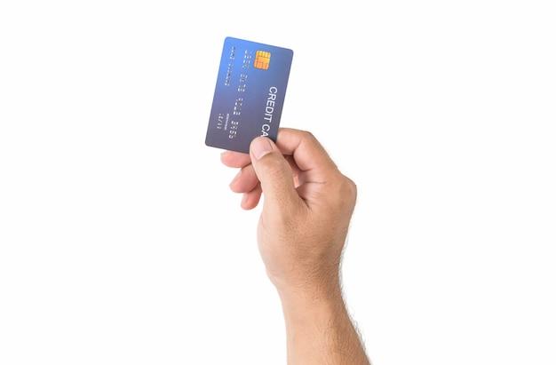 Wręcza mężczyzna trzyma kredytową kartę odizolowywająca na bielu, biznesie i pieniądze dla robić zakupy online