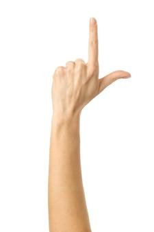 Wskazując w górę. kobieta ręka z francuskim manicure gestykuluje na białym tle na białej ścianie. część serii