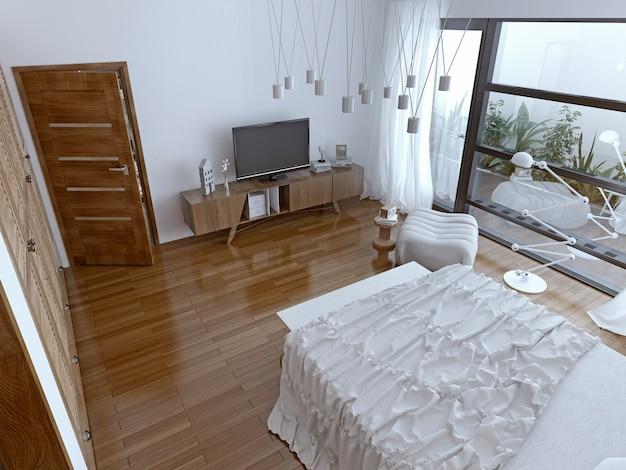 Współczesna sypialnia z panoramicznym oknem.