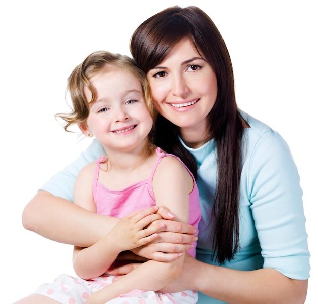 Wspólnota młoda piękna kobieta z małą córeczką - na białym tle