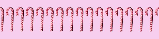 Wstążka bez szwu deseń czerwone i białe klepki cukierki świąteczne