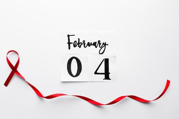 Wstążka długiego szpiczaka poniżej pisania 4 lutego