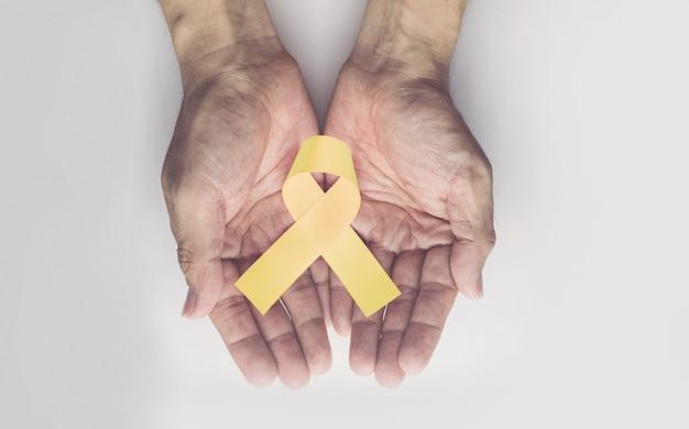 Wstążka złota świadomości raka dzieciństwa