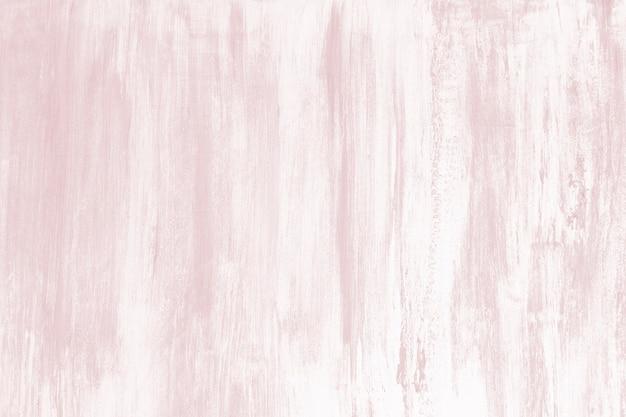 Wyblakły pastelowy różowy betonowy mur z teksturą tła