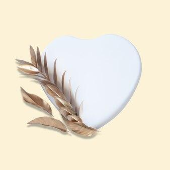 Wycinanka w kształcie serca ze złotymi liśćmi koncepcji miłości połóż się na pastelowym żółtym tle