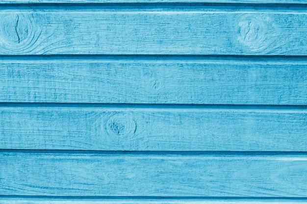 Wygląd drewnianych niebieskich desek. tło drewna z miejsca na kopię