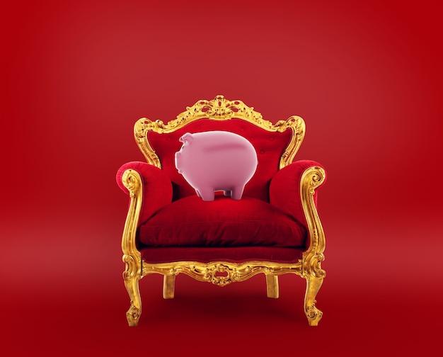 Wygodny czerwono-złoty fotel ze skarbonką. koncepcja jako najlepsza usługa oszczędnościowa