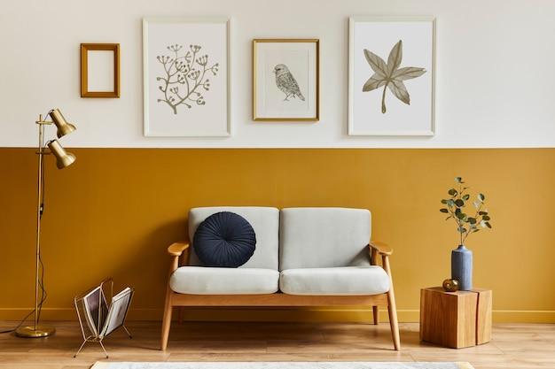 Wyjątkowy salon w nowoczesnym stylu z designerską sofą, elegancką drewnianą kostką, lampą, ramkami, kwiatami w wazonie