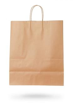 Wykonuje ręcznie papierową torbę odizolowywającą na białym tle. koncepcja sprzedaży.