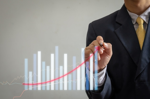 Wykres biznesowy wzrostu i postępu firmy oraz analiza planowania finansowego i inwestycyjnego.
