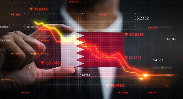 Wykres spada przed flagą bahrajnu. pojęcie kryzysu