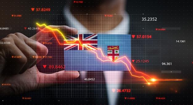 Wykres spada przed flagą fidżi. pojęcie kryzysu