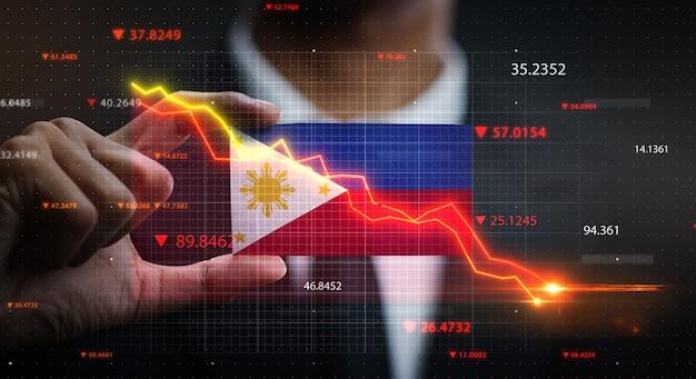 Wykres spada przed flaga filipin. pojęcie kryzysu