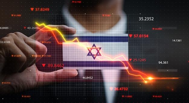 Wykres spada przed flagą izraela. pojęcie kryzysu
