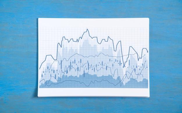 Wykresy biznesowe na niebieskim tle