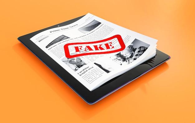 Wysoki kąt tabletu z papierami i fałszywymi wiadomościami