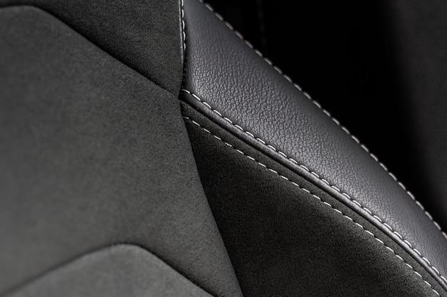 Wysoki kąt widzenia nowoczesnych foteli samochodowych. szczegółowa tekstura fotelika samochodowego i szczegóły wnętrza. szczegółowy obraz ściegu plis samochodowych.