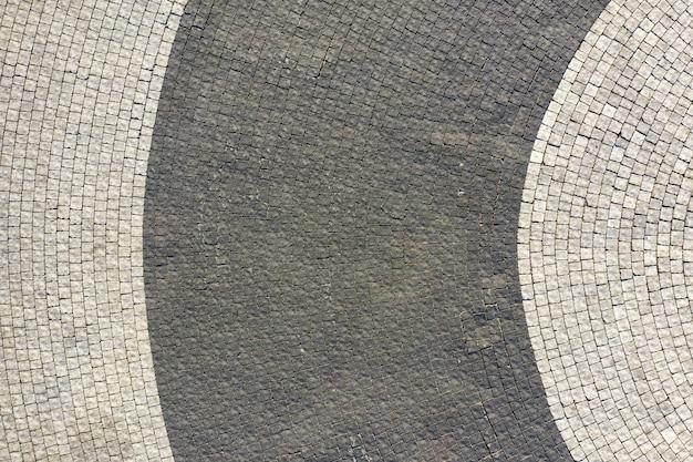 Wysokiej jakości płyty chodnikowe, do układania ścieżek, parkingów, ulic. wygląd drona, tekstura.