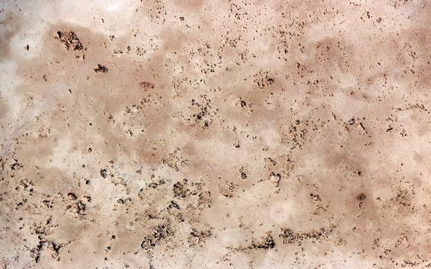 Wysokiej jakości tekstura naturalnego kamienia, żółtego trawertynu lub marmuru