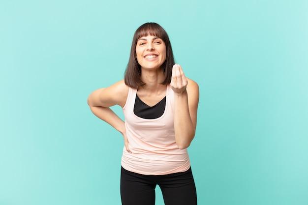 Wysportowana kobieta wykonująca gest kaprysu lub pieniędzy, nakazująca spłatę długów!