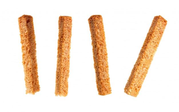 Wznosi toast chlebowe kruszki odizolowywać na białym tle