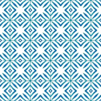 Wzór akwarela chevron. niebieski ekstatyczny letni projekt w stylu boho. zielona geometryczna granica akwarela chevron. tekstylny, niepowtarzalny nadruk, tkanina na stroje kąpielowe, tapeta, opakowanie.