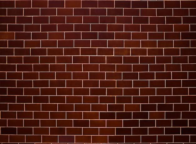 Wzór muru ceglanego. brązowe i szare tło powierzchni. bloki i konstrukcje cementowe. streszczenie tekstura cegły. projekt wzoru ilustracji