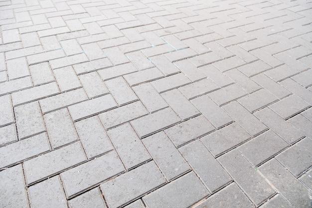 Wzór podłogi bloku betonowa kostka brukowa na tle