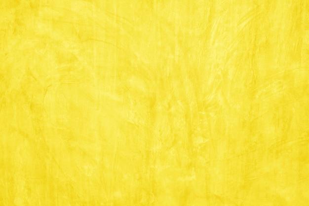 Wzór powierzchni piękny żółty cement tekstury tła