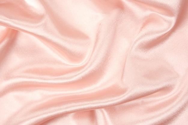 Wzór tkaniny. różowa tkanina tekstura do projektowania dekoracji, streszczenie tło.