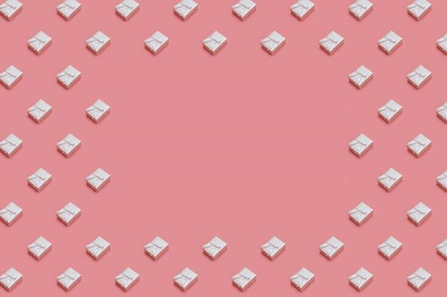 Wzór wykonany z białych pudełek na pastelowym różowym tle. prezentuje w rzucie izometrycznym
