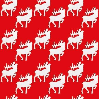 Wzór z białą drewnianą figurą jelenia z dużymi rogami.