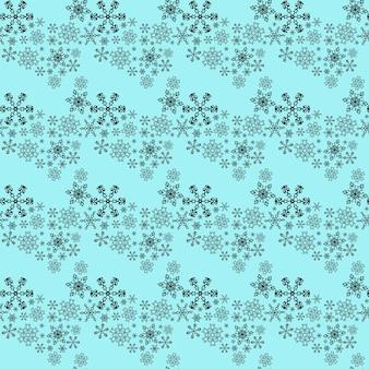 Wzór z płatki śniegu na niebieskim tle.