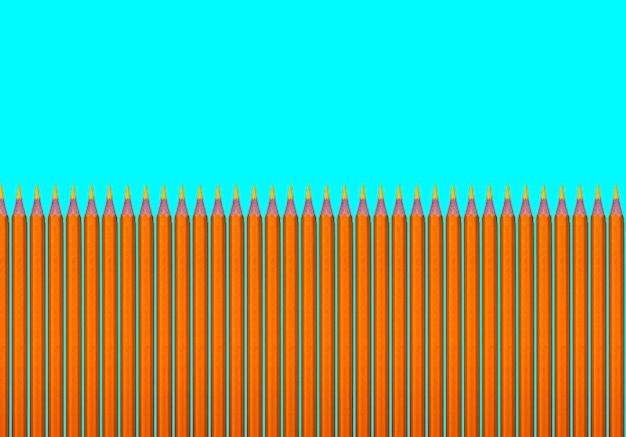 Wzór żółtych ołówków na turkusowym tle