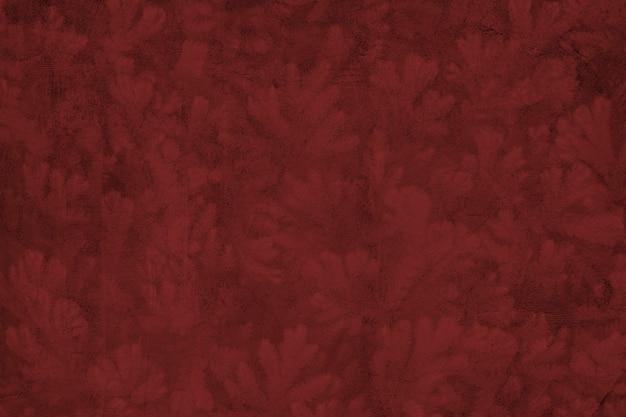 Wzorzyste czerwone tło z teksturą betonu