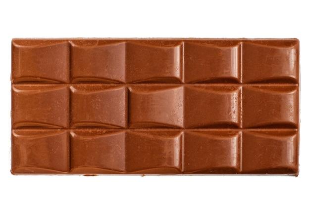 Yummy milk chocolate bar na białym tle. widok z góry.