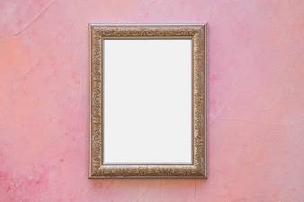 Złota ozdobna biel rama na menchii ścianie